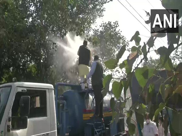 NDMC Mayor Jai Prakash waters trees in Karol Bagh on Thursday. (Photo/ANI)