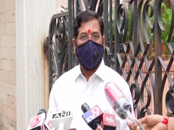 Maharashtra Cabinet Minister Eknath Shinde talking to reporters on Sunday. Photo/ANI