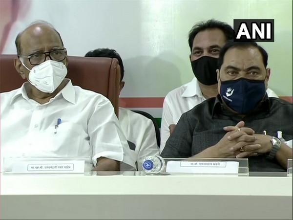 Eknath Khadse (right) with NCP Maharashtra chief Sharad Pawar. (Photo/ANI)