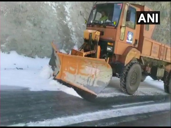 Snow being cleared from Mughal Road in J-K's Rajouri district. (Photo/ANI)