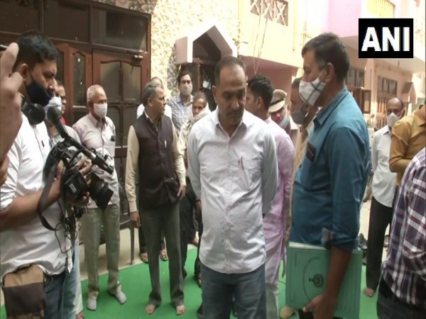 SIT officials at the Ballabgarh murder victim's residence. (Photo/ANI)