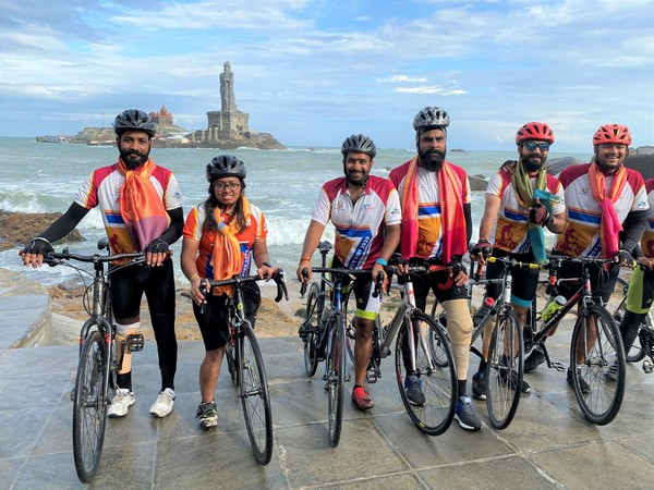 Elated Infinity Ride 2020 cyclists pose in front of Vivekananda Rock Memorial