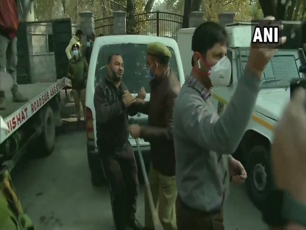 Police detain a PDP worker during a protest near Sports Complex in Srinagar on Thursday. (Photo/ANI)