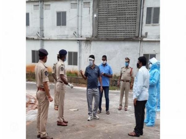 Police gathered around the COVID care centre in Eluru city, Andhra Pradesh. (Photo/ANI)