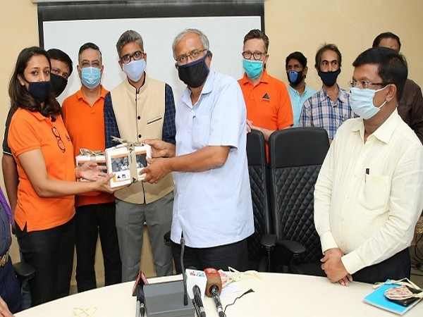 Embassy Office Parks hands over sanitizers to the Education Minister S Suresh Kumar