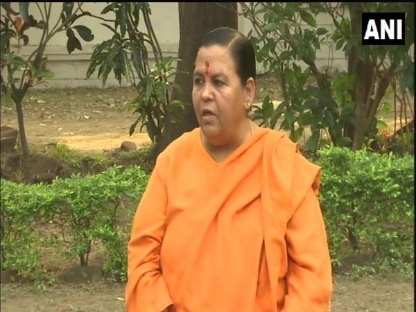 "BJP leader Uma Bharti says Congress leader Kamal Nath is like her ""elder brother"". (Photo/ANI)"