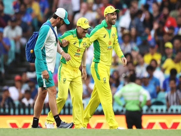 Australian batsman David Warner being assisted out of the field (Photo/ cricket.com.au Twitter)