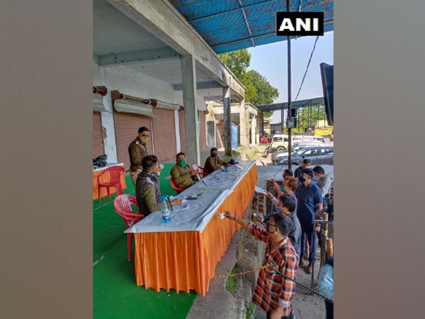 COVID-19 testing being conducted at Aasarodhi Inter-State Check Post. (Photo/ANI)