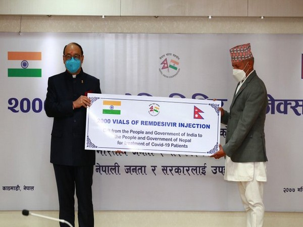 Foreign Secretary Harsh V Shringla providing COVID-19 related medical assistance to Nepal Foreign Minister Pradeep Kumar Gyawali on Thursday (Source: Twitter)