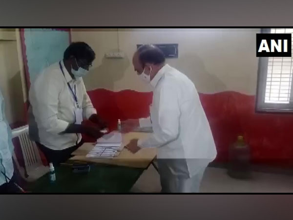 Telangana Home Minister Mohammed Mahmood Ali casting his vote today in Hyderabad. [Photo/ANI]
