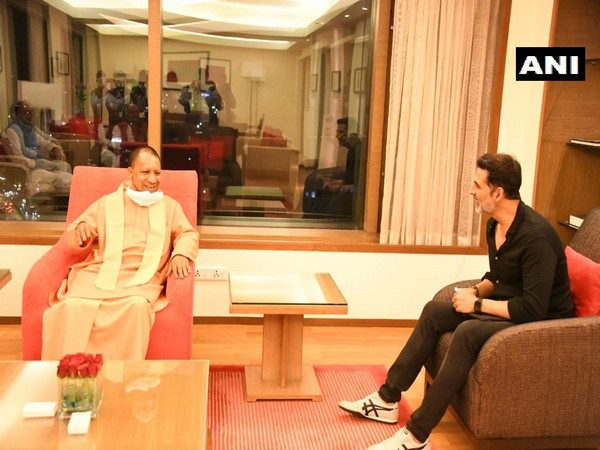 Bollywood actor Akshay Kumar in conversation with UP CM Yogi Adityanath in Mumbai on Tuesday night.