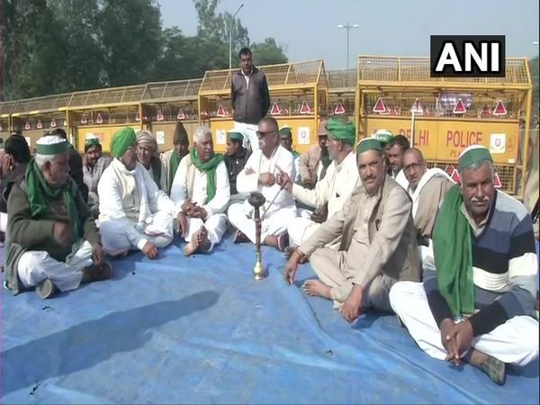 Farmers protest near Gautam Budh Dwar on Delhi-Noida Link Road on Thursday. (Photo/ANI)