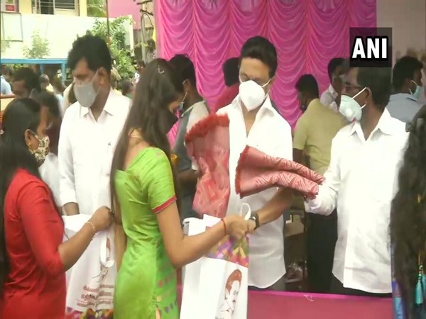 DMK president distributing relief material at Ambedkar nagar on Monday (Photo/ANI)
