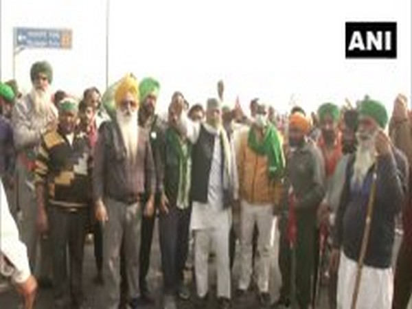 Farmers protest at one of the Delhi borders on Tuesday. (Photo/ANI)