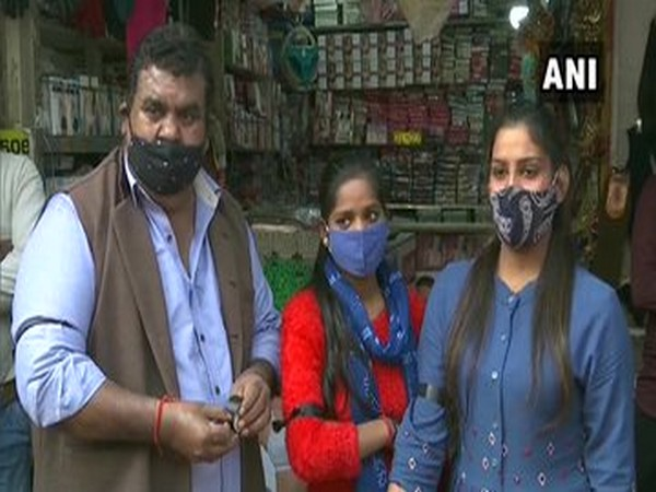 In Delhi's Sarojini Nagar market, shopkeepers tied black ribbons around their arms to extend solidarity with farmers.