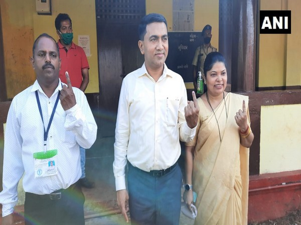 Chief Minister Pramod Sawant along with his wife voted from Pale Zilla panchayat seat (Photo/ANI)