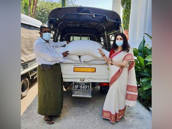 Indian Women's Association of Yangon (IWAY) President Smriti Srivastav donating food rations in Myanmar (Source: India in Myanmar/Twitter)