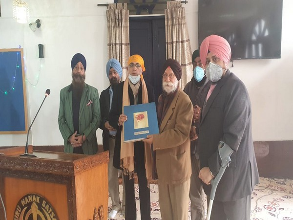 Indian Ambassador Vinay Mohan Kwatra gifting Nepal the book issued by the Government of India to mark the 550th birth anniversary of Guru Nanak Dev. (Twitter/India in Nepal)