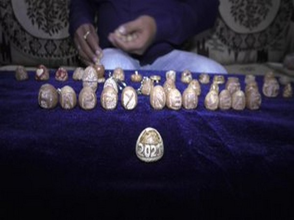 A miniature artist from Surat, Pavan Sharma has carved various things on betel nuts (Photo/ANI)