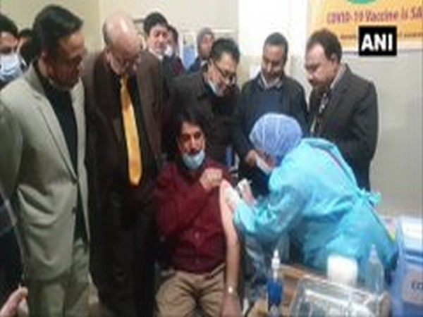 Health workers were given COVID-19 vaccine shots in Doda district, Jammu and Kashmir on Saturday (Photo/ANI)