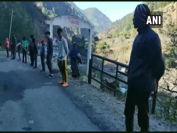 A 19 km long human chain was formed to demand widening of road in Uttarakhand [Photo/ANI]