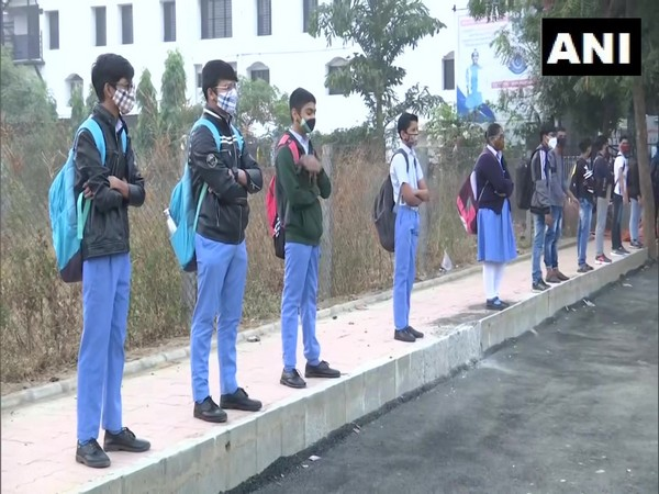 Students maintain social distancing at a school in Ahmedabad. (Photo/ANI)