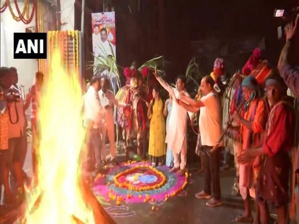 Andhra Pradesh Endowments Minister Vellampalli Srinivasa Rao celebrating Bhogi with his family. (Photo/ANI)