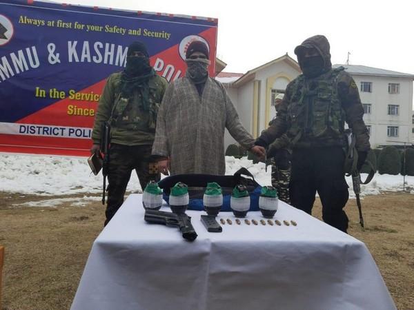 The Jammu and Kashmir Police with the apprehended JeM terrorist. (Photo/ANI)