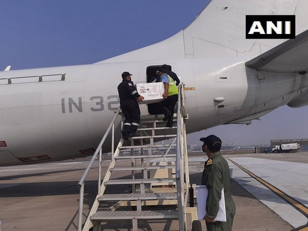 Indian Navy P-8I maritime reconnaissance aircraft loading #COVID19 vaccines that will be supplied to Mauritius and Seychelles (Photo/ANI)
