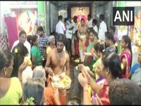 AMMK workers on Sunday offered prayers at a temple in Madurai (Photo/ANI)