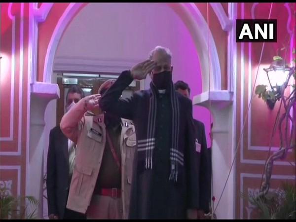 Ashok Gehlot hoisting the tricolour at his residence in Jaipur.