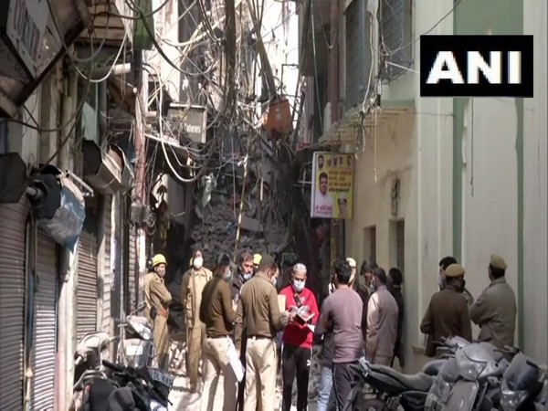 Police personnel at the site where building collapsed in Delhi. (Photo/ANI)