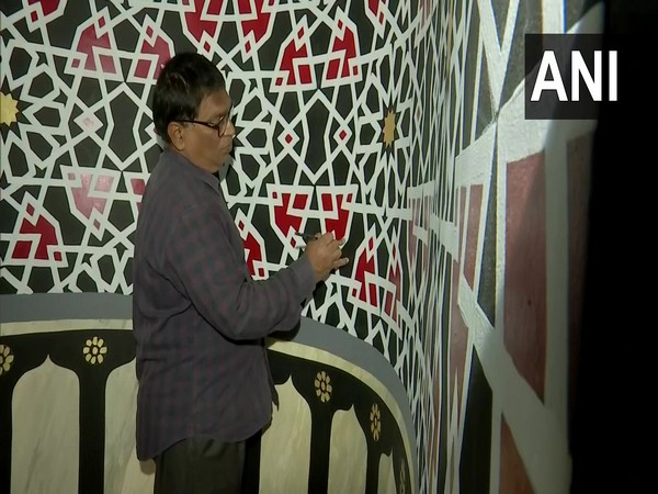 Anil Kumar Chawhan painting the walls of a mosque in Hyderabad. (Photo/ANI)