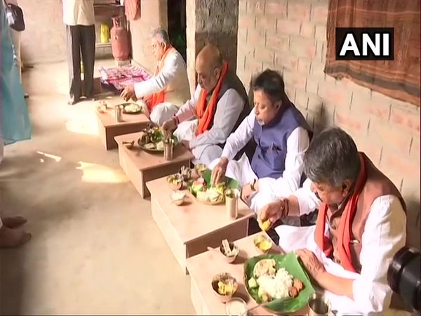 Union Home Minister Amit Shah and senior BJP leaders having lunch in Narayanpur village (Photo/ANI)