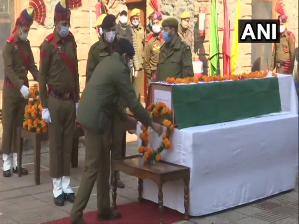 Wreath laying ceremony of SPO Mohammad Altaf being held in Srinagar. (Photo/ANI)