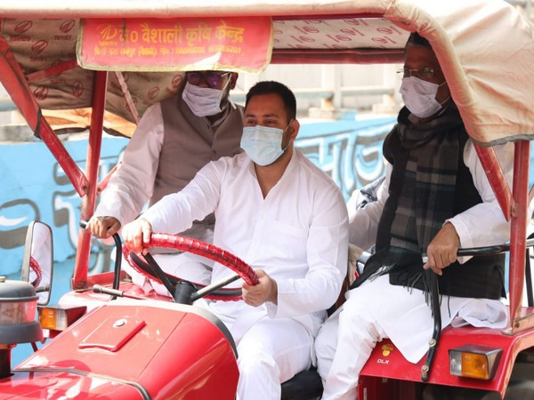 RJD leader Tejashwi Yadav driving tractor in Patna