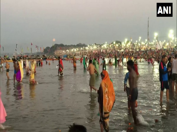 Devotees taking holy sips on the occasion of Magh Purnima. (Photo/ANI)