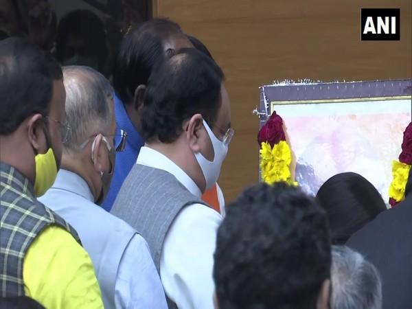 BJP national president JP Nadda pays tributes to poet-saint Ravidas in New Delhi on Saturday. [Photo/ANI]