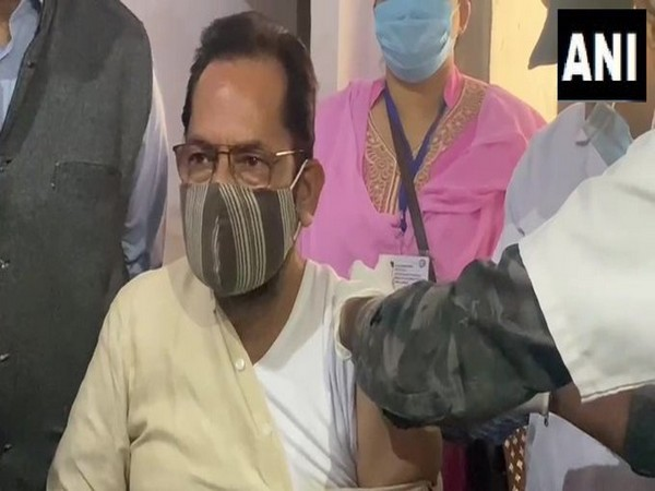 Union Minister Mukhtar Abbas Naqvi receiving first dose of COVID-19 vaccine (Photo/ANI)