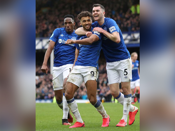 Dominic Calvert-Lewin celebrates scoring their third goal with Michael Keane and Yerry Mina