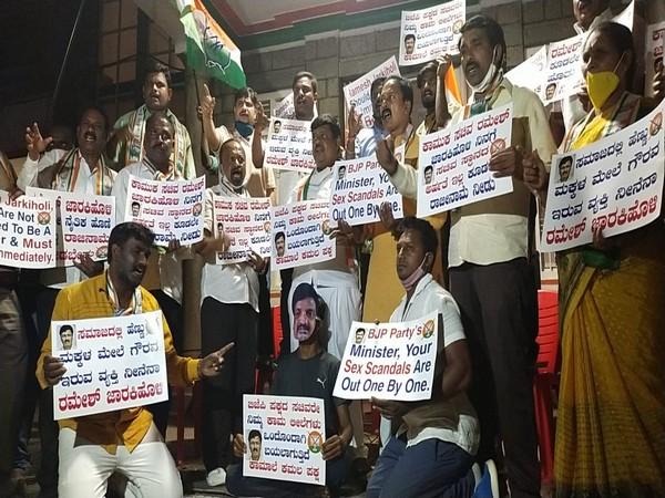 Congress workers protesting against Karnataka cabinet minister Ramesh Jarkiholi. (Photo/ANI)