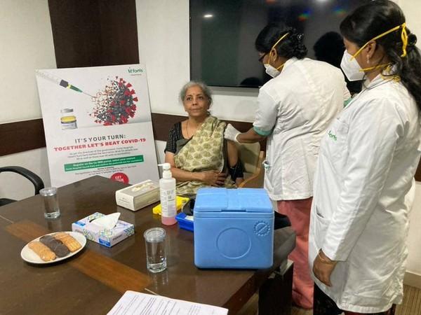 Union Finance Minister Nirmala Sitharaman receiving first dose of COVID-19 vaccine (Photo/ANI)