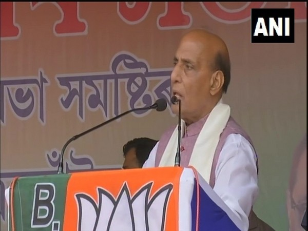 Defence Minister Rajnath Singh addressing a rally in Dergaon of Assam's Golghat district. (Photo/ANI)