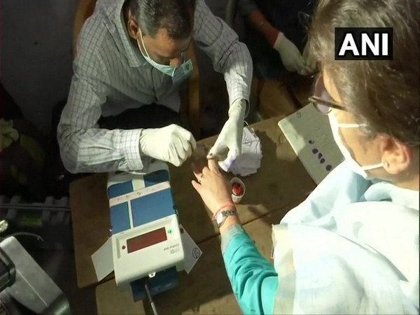 Congress leader Sushmita Dev casting her vote at a polling station in Silchar (Photo/ANI)