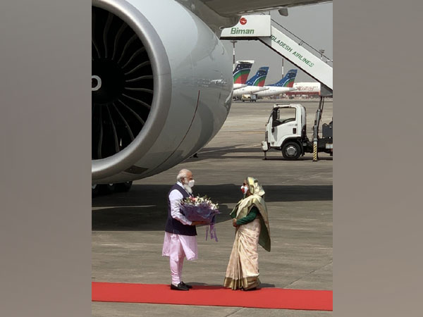 Prime Minister Narendra Modi with his Bangladeshi counterpart Sheikh Hasina at Dhaka Airport on Friday. (Source: Twitter/PMO)