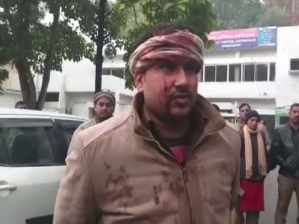 Sandeep, the constable in the Excise department talking to reporters in Ghaziabad on Wednesday. Photo/ANI