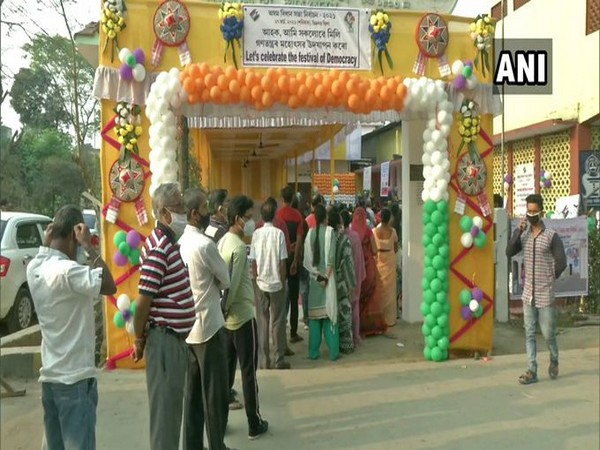 Voters stand in queue outside a polling booth in Dibrugarh (Photo/ANI)