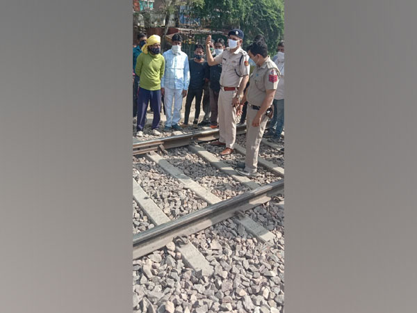 Railway officials at the site where considerable breakage in the railway track was reported near Mangolpuri in Delhi on Saturday. [Photo/ANI]