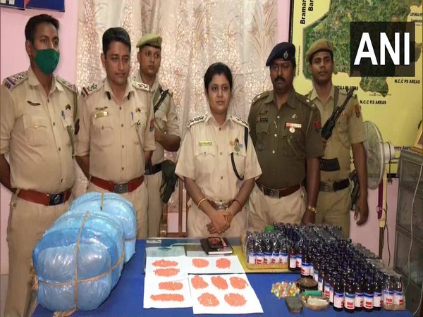 Sub-Divisional Police Officer Priya Madhuri Majumder (centre) and tehe seized drugs. (Photo/ANI)