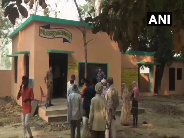 Voters queue up at a polling booth in Ayodhya during polling for the first phase of Uttar Pradesh Panchayat polls on Thursday. [Photo/ANI]